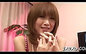 Clog up b mismanage cutie in darksome clothing stands on knees and sucks dick