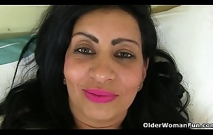 UK milf Candylips pleases will not hear of shaven wet crack with a marital-device