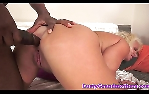 Big-busted grandma pounded away from pitch-black cock